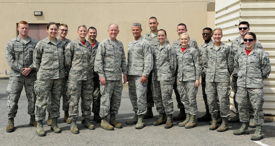 U.S. Air Force Maj. Gen. Donald Dunbar, Wisconsin's adjutant general, and Chief Master Sgt. Thomas Safer, 115th Fighter Wing command chief, pose for a photo with Airmen from the 115th FW, at Kunsan Air Base, Republic of Korea, Sept. 15, 2017. Dunbar and Safer visited the 115th FW Airmen deployed to Kunsan for a 4-month rotation as part of a Theater Security Package, which helps maintain regional security and stability.  (U.S. Air Force photo by Senior Airman Colby L. Hardin)