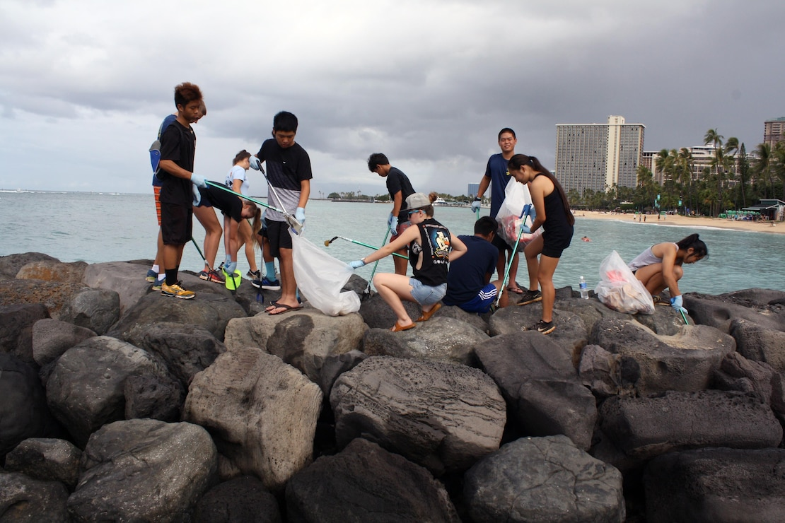 More than 80 volunteers scoured Fort DeRussy park and beach berm Sept. 9, picking up trash and clearing debris as part of this year's National Public Lands Day celebrations, including Junior Reserve Officers Training Course (JROTC) students from Punahou High School and other local schools led by Lt. Col. (ret.) Robert Takao, commander of the JROTC at Punahou High School.
