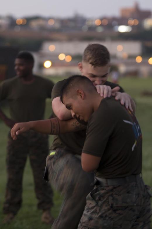 Cpl. Jody Scott demonstrates a Marine Corps Martial Arts Program technique during a grueling class