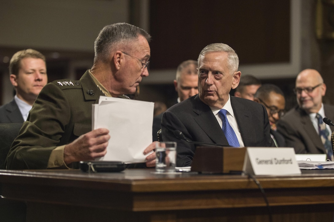 Defense Secretary James N. Mattis and the chairman of the Joint Chiefs of Staff talk during a budget hearing.