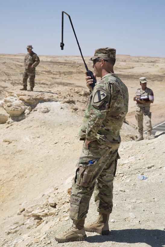 Army Lt. Col. William Wade, commander of the 2nd Battalion, 7th Cavalry Regiment, 3rd Armored Brigade Combat Team, 1st Cavalry Division communicates with tank crews at a combined live fire exercise (CALFEX) rehearsal during Exercise Bright Star 2017. Bright Star is a combined command-post and field training exercise aimed at enhancing regional security and stability by responding to modern day security scenarios with the Arab Republic of Egypt. (U.S. Department of Defense photo by Tom Gagnier)