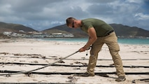 U.S. Marine Cpl. Kyler S. Barrett, a landing support specialist with Joint Task Force - Leeward Islands, assembles the Lightweight Water Purification System at Orient Beach, Saint Martin, Sept. 16, 2017. The Marines arrived to assess possible locations to set up their LWPS in order to produce potable water for communities on the island most affected by Hurricane Irma. At the request of partner nations, JTF-LI deployed aircraft and service members to areas in the eastern Caribbean Sea impacted by the storm. The task force is a U.S. military unit composed of Marines, Soldiers, Sailors, and Airmen, and represents U.S. Southern Command's primary response to Hurricane Irma.