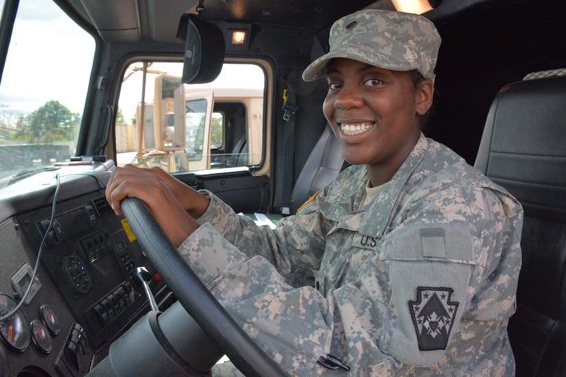 Army Spc. Breyonnha Chester, a motor transport operator with the Pennsylvania Army National Guard's Detachment 1, 1067th Transportation Company, 213th Regional Support Group, sits ready at the wheel of her M915 truck, which she drove from Pennsylvania to Texas and back to provide relief supplies and equipment to those affected by Hurricane Harvey, Sept. 10, 2017. Army National Guard photo by Sgt. Shane Smith