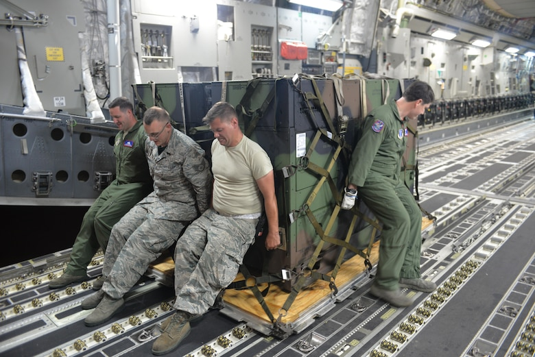 U.S. Air Force Tech. Sgt. Taylor Grover, Loadmaster, 183rd Airlift Wing Mississippi Air National Guard, Staff Sgt. Andrew Norton , air transportation specialist, 157th Logistic Readiness Squadron, New Hampshire ANG, Staff Sgt. Ryan Olszewski , air transportation journeyman, N.H. ANG and Master Sgt. Brandon Moseley, Loadmaster, 183rd Airlift Wing, MS, ANG, load cargo onto a C-17A Globemaster. The cargo is part of the Disaster Relief Bed Down Kit (DRBS) deploying from Pease ANGB. to the Virgin Islands in support of the Irma relief effort.  The DRBS kit is one of two kits stored here at Pease Air National Guard Base.  (N.H. Air National Guard Photo by Master Sgt. Thomas Johnson)