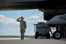 U.S. Airman 1st Class Luke Ikeda, a crew chief assigned to the 169th Aircraft Maintenance Squadron, salutes a F-16 Fighting Falcon fighter pilot assigned to the South Carolina Air National Guard's 169th Fighter Wing at McEntire Joint National Guard Base, S.C., Sept. 16, 2017. Ikdea was recognized as an outstanding Airman by his supervisors and his peers and was the Airman Spotlight subject for the month of October. (U.S. Air National Guard photo by Senior Airman Megan Floyd)