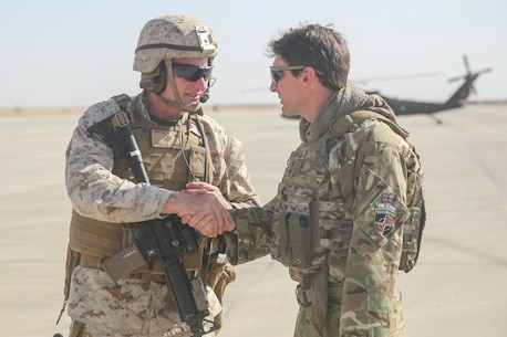 Brig. Gen. Roger Turner, the commanding general for Task Force Southwest, greets British Army Maj. Gen. Charles Herbert, the Resolute Support senior advisor to the Minister of Interior, at Bastian Airfield, Afghanistan, Sept. 11, 2017. The purpose of the visit for the Afghan Minister of Interior  was an introduction to the leadership of 505th Zone National Police and an opportunity to meet some of the MOI forces at Bost Airfield. (U.S. Marine Corps photo by Sgt. Lucas Hopkins)