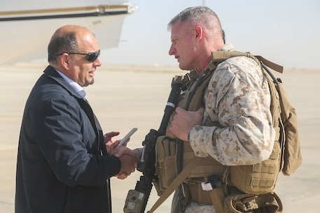 Brig. Gen. Roger Turner, the commanding general for Task Force Southwest, greets Wais Ahmad Barmak, the Minister of Interior for Afghanistan, at Bastian Airfield, Afghanistan, Sept. 11, 2017. The purpose of the visit for the Afghan Minister of Interior was an introduction to the leadership of 505th Zone National Police and an opportunity to meet some of the MOI forces at Bost Airfield. (U.S. Marine Corps photo by Sgt. Lucas Hopkins)