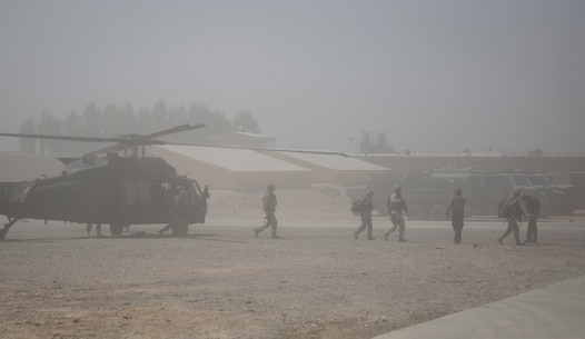 Wais Ahmad Barmak, the Minister of Interior for Afghanistan, and British Army Maj. Gen. Charles Herbert, the Resolute Support senior advisor to the MOI, disembark off a UH-60 Blackhawk for a key leader engagement with Afghan National Defense and Security Force key leaders at Bost Airfield, Afghanistan, Sept. 11, 2017. The key leaders came together to discuss a better way to streamline processes for supply, promotions, training opportunities, the distribution of vehicles and weapons, as well as what can be done to counter the corruption that is present in Helmand Province. (U.S. Marine Corps photo by Sgt. Justin T. Updegraff)