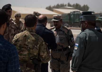 Wais Ahmad Barmak, the Minister of Interior for Afghanistan, greets Afghan National Defense and Security Force key leaders at Bost Airfield, Afghanistan, Sept. 11, 2017. The key leaders came together to discuss a better way to streamline processes for supply, promotions, training opportunities, the distribution of vehicles and weapons, as well as what can be done to counter the corruption that is present in Helmand Province. (U.S. Marine Corps photo by Sgt. Justin T. Updegraff)