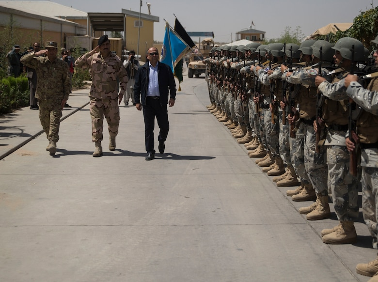 Wais Ahmad Barmak, right, the Minister of Interior for Afghanistan, Brig. Gen. Daud Ghulam Tarakhel, center, the commanding general of the 505th Zone National Police, are greeted by a formation of Afghan National Policemen at Bost Airfield, Afghanistan, Sept. 11, 2017. The key leaders came together to discuss a better way to streamline processes for supply, promotions, training opportunities, the distribution of vehicles and weapons, as well as what can be done to counter the corruption that is present in Helmand Province. (U.S. Marine Corps photo by Sgt. Justin T. Updegraff)
