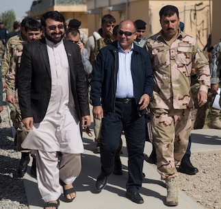 Wais Ahmad Barmak, center, the Minister of Interior for Afghanistan, Governor Hayatullah Hayat, left, the governor of Helmand Province, and Brig. Gen. Daud Ghulam Tarakhel, right, the commanding general of the 505th Zone National Police, walk and talk after the conclusion to a key leader engagement at Bost Airfield, Afghanistan, Sept. 11, 2017. The key leaders came together to discuss a better way to streamline processes for supply, promotions, training opportunities, the distribution of vehicles and weapons, as well as what can be done to counter the corruption that is present in Helmand Province. (U.S. Marine Corps photo by Sgt. Justin T. Updegraff)
