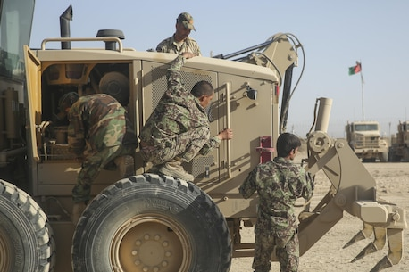 Afghan National Army engineer soldiers with 215th Corps inspect a Caterpillar 120M Motor Grader prior to levelling a road at Camp Shorabak, Afghanistan, Sept. 18, 2017. More than 20 soldiers assigned to various engineer kandaks throughout Helmand province are executing a five-week Heavy Equipment Maintenance Operator Course, which is designed to improve the soldiers' route clearance skills and develop their technical abilities using large vehicles. (U.S. Marine Corps photo by Sgt. Lucas Hopkins)
