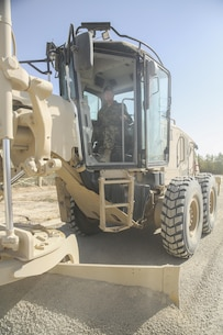 An Afghan National Army engineer soldier with 215th Corps levels a road using a Caterpillar 120M Motor Grader at Camp Shorabak, Afghanistan, Sept. 18, 2017. U.S. Marine route clearance advisors with Task Force Southwest are currently holding a five-week Heavy Equipment Maintenance Operator Course with their Afghan counterparts. More than 20 ANA soldiers assigned to various engineer kandaks from throughout Helmand province are participating in the course, which is designed to build their technical proficiency using large vehicles and strengthen their route clearance capabilities. (U.S. Marine Corps photo by Sgt. Lucas Hopkins)
