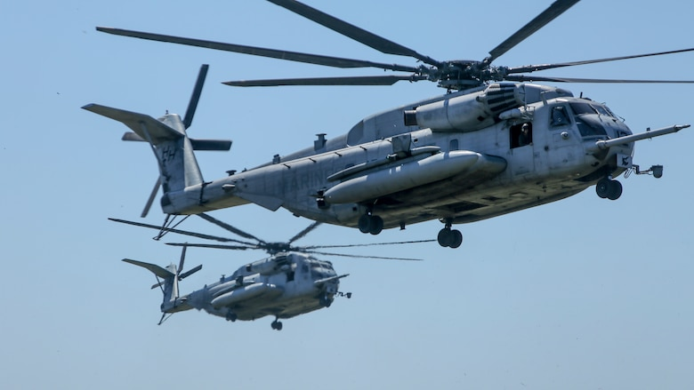 Two CH-53E Super Stallion helicopters prepare to land during aerial insert drills at Camp Lejeune, N.C., Sep. 13, 2017. The exercise is part of a Marine Corps Combat Readiness Evaluation to test the unit's capabilities in a combat environment. The Marines are with 1st Battalion, 6th Marine Regiment. (U.S. Marine Corps photo by Lance Cpl. Holly Pernell)