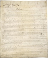 An image of the first page of the U.S. Constitution.