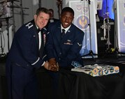 U.S. Air Force Col. Christopher Amrhein, 100th Air Refueling Wing commander, and U.S. Airman Leoncio Daniels, 100th Logistics Readiness Squadron ground transportation personnel, cut a birthday cake for the Air Force birthday celebration Sept. 16, 2017, in Duxford, England.  The U.S.  Air Force celebrates 70 years of service after becoming its own independent branch of the military on Sept. 18, 1947. (U.S. Air Force photo by Airman 1st Class Luke Milano)