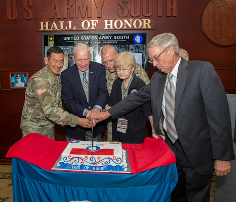 Maj. Gen. K.K. Chinn and the family members of two of the inductees Gen. Walter Kruger and Capt. Hal Kopp (Alamo Scouts) along with retired Col. Ralph Puckett cut the cake at the inaugural Hall of Honor ceremony Sept. 14 at Joint Base San Antonio-Fort Sam Houston.