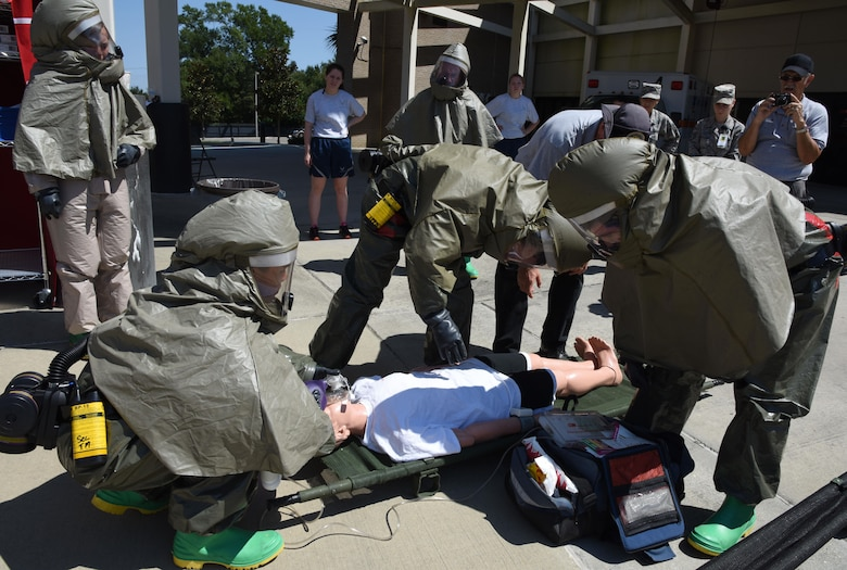 "Members of the 81st Medical Group administer triage to a ""patient"" during the 81st MDG integrated in-place patient decontamination training course behind the Keesler Medical Center Sept. 14, 2017, on Keesler Air Force Base, Mississippi. The two-day course trained 21 personnel, which came from four different disaster medical teams: IPPD, triage, manpower and security. Throughout the training, they learned to utilize Keesler's fixed decontamination facility and how to set up and tear down the decontamination tent. (U.S. Air Force photo by Kemberly Groue)"