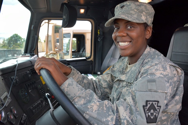 Army Spc. Breyonnha Chester, a motor transport operator with the Pennsylvania Army National Guard's Detachment 1, 1067th Transportation Company, 213th Regional Support Group, sits ready at the wheel of her M915 truck, Sept. 10, 2017. She drove from Pennsylvania to Texas and back to provide relief supplies and equipment to those affected by Hurricane Harvey. Army National Guard photo by Sgt. Shane Smith