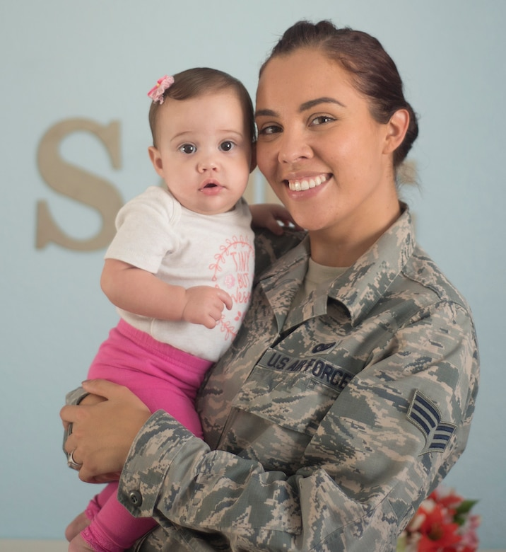 Senior Airman Shelby Horn poses for a portrait with her daughter Sadie