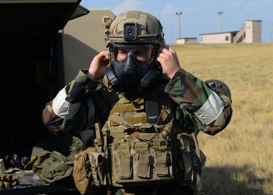 Senior Airman Parker Davis, an explosive ordnance disposal technician assigned to the 28th Civil Engineer Squadron, dons his protective gear during an EOD Team of the Year competition at Ellsworth Air Force Base, S.D., Sept. 12, 2017. During the competition, technicians were subjected to eight different scenarios that they needed to work through as part of a team of three. (U.S. Air Force photo by Airman Nicolas Z. Erwin)
