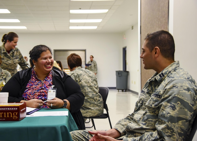 Capt. George Devitta, 23d Medical Group physician's assistant, left, speaks to Regina K. Wisenbacker, a local medical professional, during a provider collaboration, Sept. 15, 2017, at Moody Air Force Base, Ga. The 23d Medical Group held this to allow base and community providers an opportunity to meet face-to-face to better understand the Airmen they are taking care of and provide feedback to help both sides improve. (U.S. Air Force photo by Airman Eugene Oliver)