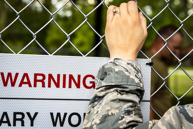 An Air Force health care provider stands outside a gate during a Military Working Dog demonstration at the provider collaboration, Sept. 15, 2017, at Moody Air Force Base, Ga. The 23d Medical Group held this to allow base and community providers an opportunity to meet face-to-face to better understand the Airmen they are taking care of and provide feedback to help both sides improve.  (U.S. Air Force photo by Airman Eugene Oliver)