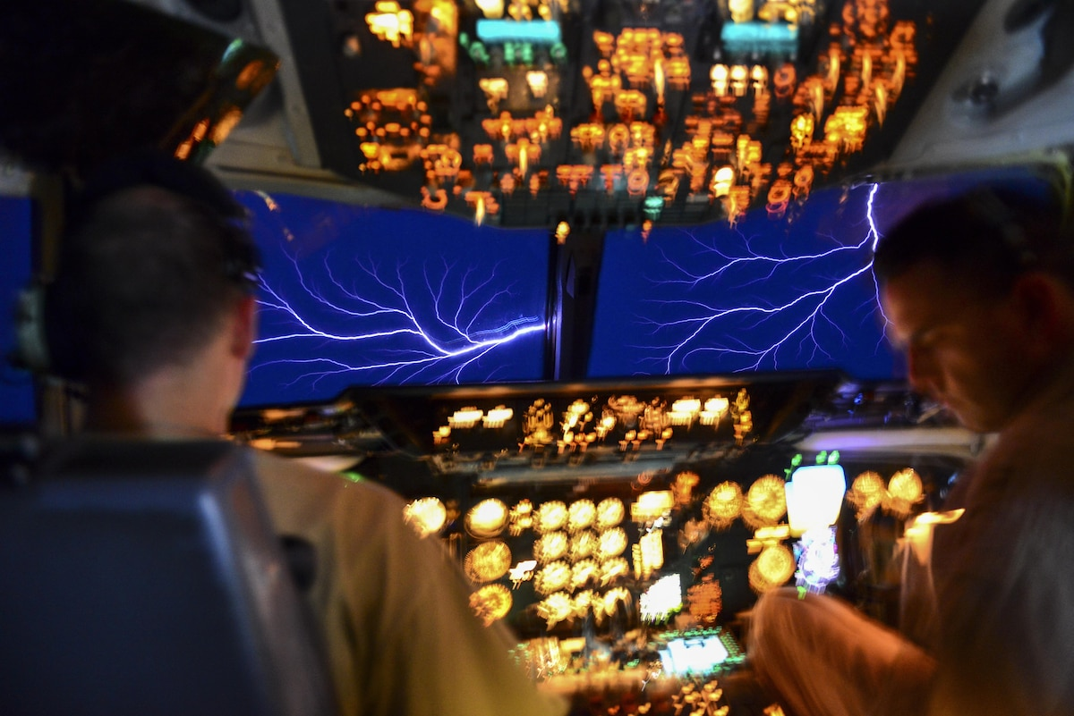 Airmen see St. Elmo's fire while flying an aircraft into a thundercloud.