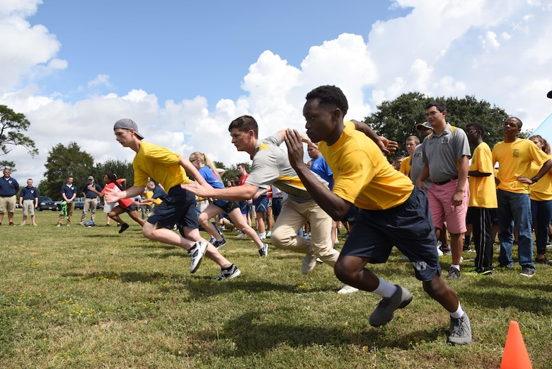 Local high school Junior ROTC cadets begin a relay race at the Science, Technology, Engineering and Mathematics Diversity Outreach Day Sept. 15, 2017, on Keesler Air Force Base, Mississippi. The event consisted of 10 Mississippi gulf coast high school Junior ROTC units viewing an 81st Security Forces Squadron military working dog demonstration and receiving information about Air Force opportunities and accession requirements with an emphasis on STEM. They also competed in several team building activities. (U.S. Air Force photo by Kemberly Groue)