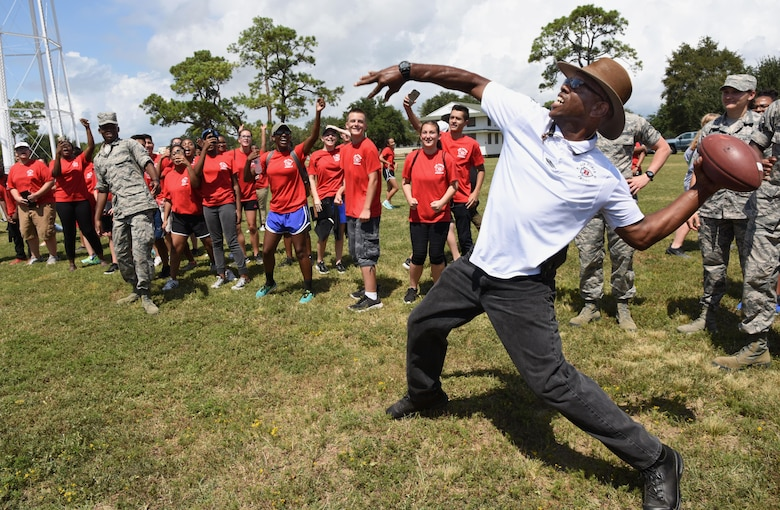 Retired Master Sgt. Steve Hinton, Biloxi High School instructor, competes in the football throwing competition at the Science, Technology, Engineering and Mathematics Diversity Outreach Day Sept. 15, 2017, on Keesler Air Force Base, Mississippi. The event consisted of 10 Mississippi gulf coast high school Junior ROTC units viewing an 81st Security Forces Squadron military working dog demonstration and receiving information about Air Force opportunities and accession requirements with an emphasis on STEM. They also competed in several team building activities. (U.S. Air Force photo by Kemberly Groue)
