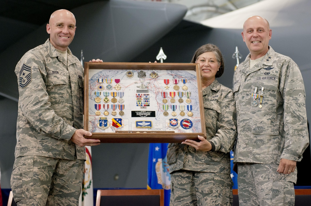 West Virginia Air National Guard Command Chief, Chief Master Sgt. James Dixon and Brig. Gen. Paige Hunter, Assistant Adjutant General, West Virginia Air National Guard, present Maj. Gen. Eric Vollmecke with a shadow box during his retirement ceremony at the 167th Airlift Wing, Martinsburg, W.Va., Sept. 16.