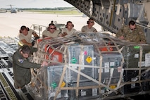 Loadmasters assigned to the 437th Airlift Wing and Airmen with the 167th small air terminal push a pallet onto a C-17 Globemaster aircraft at the 167th Airlift Wing, Sept 10.