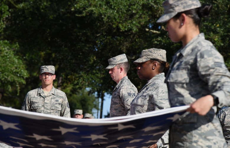 Keesler personnel participate in a flag folding ceremony during the POW/MIA Retreat Ceremony Sept. 15, 2017, on Keesler Air Force Base, Mississippi. The event, hosted by the Air Force Sergeants Association Chapter 652, was held to raise awareness and pay tribute to all prisoners of war and military members still missing in action. (U.S. Air Force photo by Kemberly Groue)