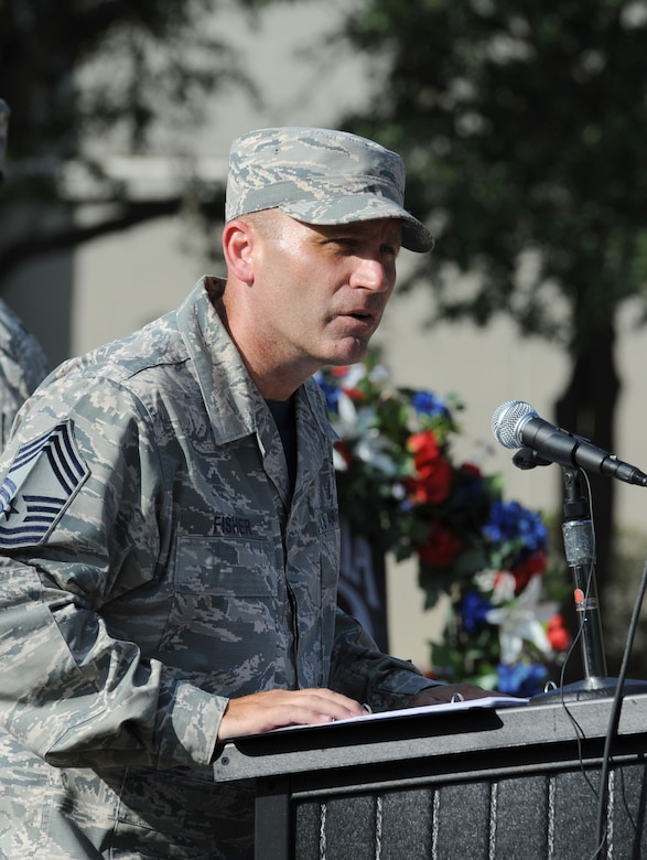 Chief Master Sgt. Anthony Fisher, 81st Training Group superintendent, delivers remarks during the POW/MIA Retreat Ceremony Sept. 15, 2017, on Keesler Air Force Base, Mississippi. The event, hosted by the Air Force Sergeants Association Chapter 652, was held to raise awareness and pay tribute to all prisoners of war and military members still missing in action. (U.S. Air Force photo by Kemberly Groue)