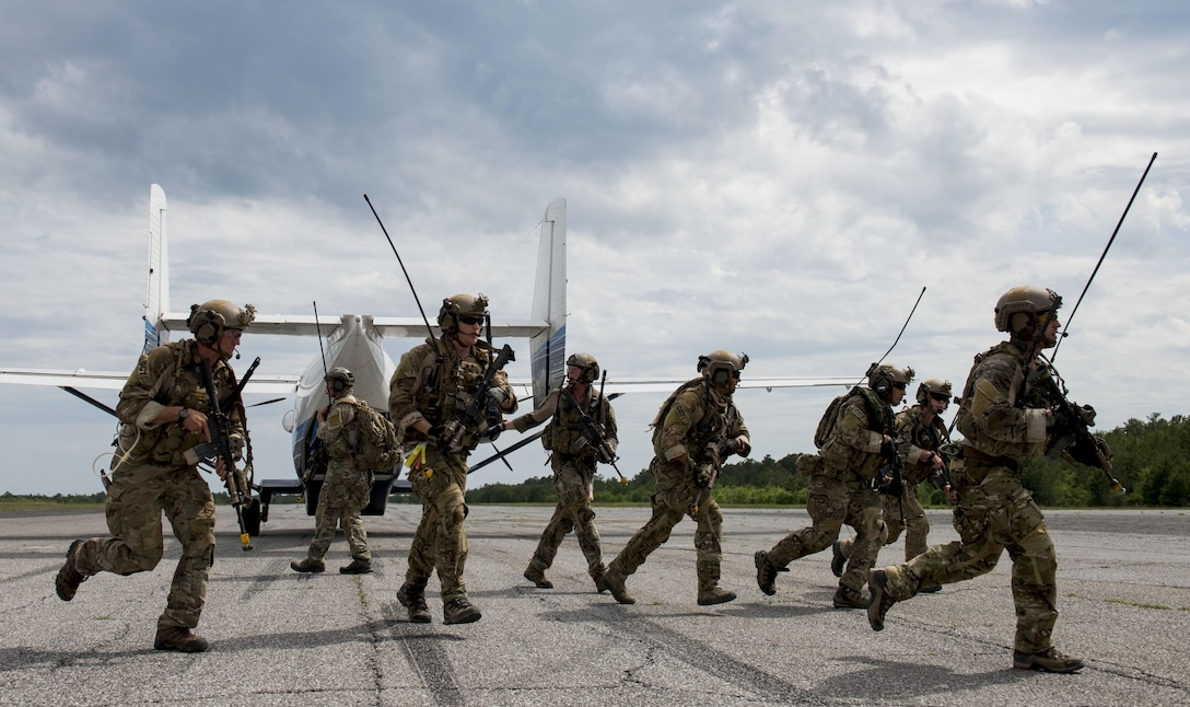 Airmen from the 23rd Special Tactics Squadron, Hurlburt Field, Fla., return to their vehicle after loading a passenger