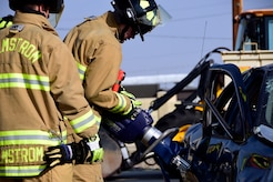 Members of the Malmstrom Air Force Base Fire Department use the Jaws of Life to remove a victim from a simulated car crash on Malmstrom Air Force Base Aug. 12, 2017.