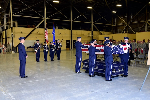 Members of the 219th RED HORSE Squadron watch as a simulated funeral is conducted at Malmstrom Air Force Base for an Airman killed by a drunk driver Aug. 12, 2017.