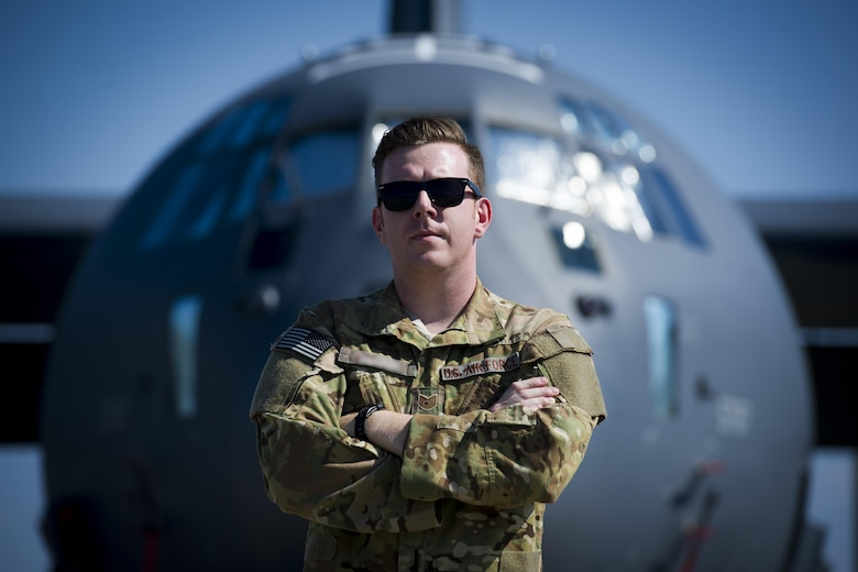 Direct Support Operator from the 25th Intelligence Squadron, U.S. Air Force Tech. Sgt. Nathan, in front of an aircraft.
