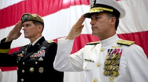 Vice Adm. John Aquilino and Gen. Joseph L. Votel salute during a change of command ceremony for U.S. Naval Forces Central Command (NAVCENT)/U.S. 5th Fleet/Combined Maritime Forces.