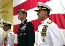 Vice Adm. John Aquilino, right, Gen. Joseph L. Votel, middle, and Vice Adm. Kevin Donegan stand at attention during a change of command ceremony for U.S. Naval Forces Central Command (NAVCENT)/U.S. 5th Fleet/Combined Maritime Forces.