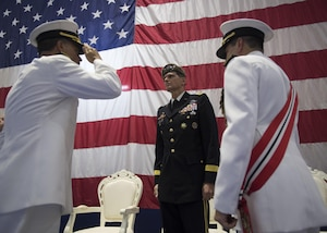 Vice Adm. John Aquilino salutes Gen. Joseph L. Votel to as he takes command of U.S. Naval Forces Central Command (NAVCENT)/U.S. 5th Fleet/Combined Maritime Forces from Vice Adm. Kevin Donegan.