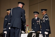 The Honor Guard sets the Prisoners of War / Missing in Action table at the Air Force ball at the McNease Convention Center in San Angelo, Texas, Sept. 15, 2017. The table is full of special symbols to remind us of those lost in service. (U.S. Photos by Airman Zachary Chapman/Released)