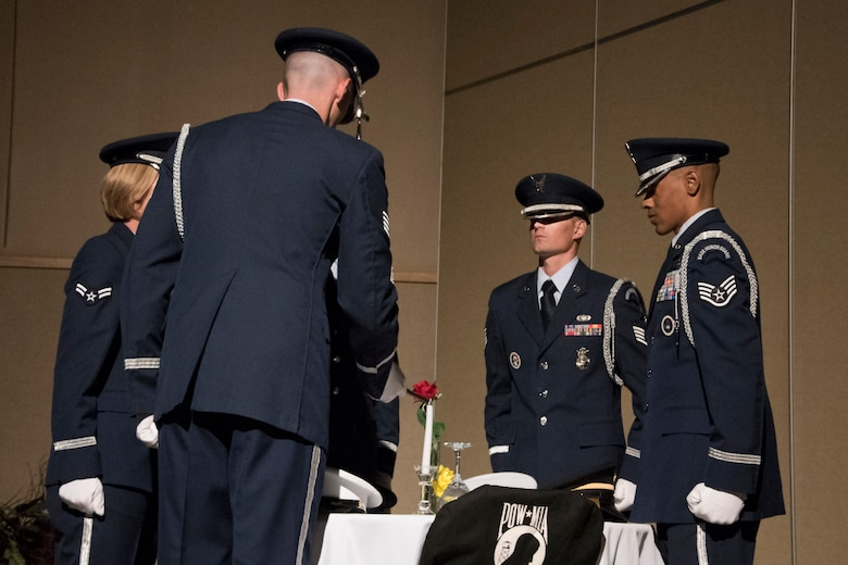 The Honor Guard sets the Prisoners of War / Missing in Action table at the Air Force ball at the McNease Convention Center in San Angelo, Texas, Sept. 15, 2017. The table is full of special symbols to remind us of those lost in service. (U.S. Air Force photo by Airman Zachary Chapman/Released)