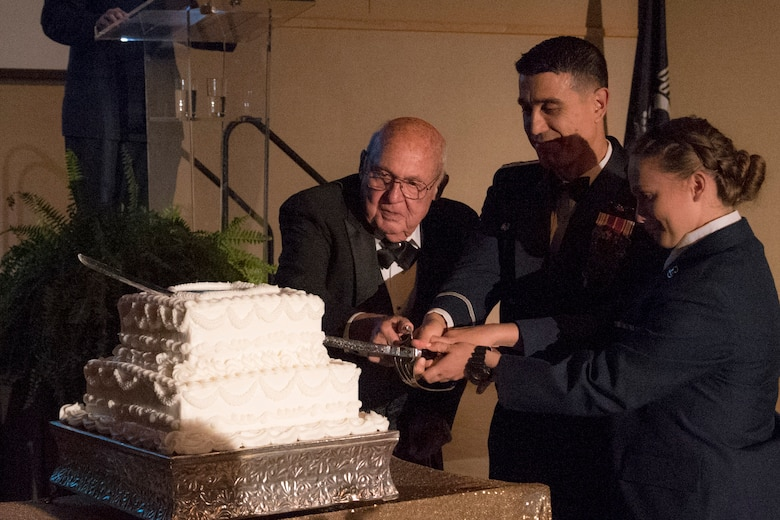 Air Force tradition is to have the oldest and the youngest service member cut the cake during the Air Force Ball held at the McNease Convention Center in San Angelo, Texas, Sept. 15, 2017.  The honor went to U.S. Air Force retired Col. Charlie Powell who was the oldest member and the youngest was Airman Hannah Guthrie, 315th student.  (U.S. Air Force photo by Airman Zachary Chapman/Released)