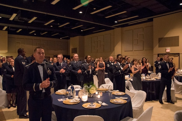 Guests sing the Air Force song and celebrate the closing of the Air Force Ball held at the McNease Convention Center in San Angelo, Texas, Sept. 15, 2017. The Air Force Ball focused on tradition and honoring the past and promoting the future. (U.S. Photos by Airman Zachary Chapman/Released)