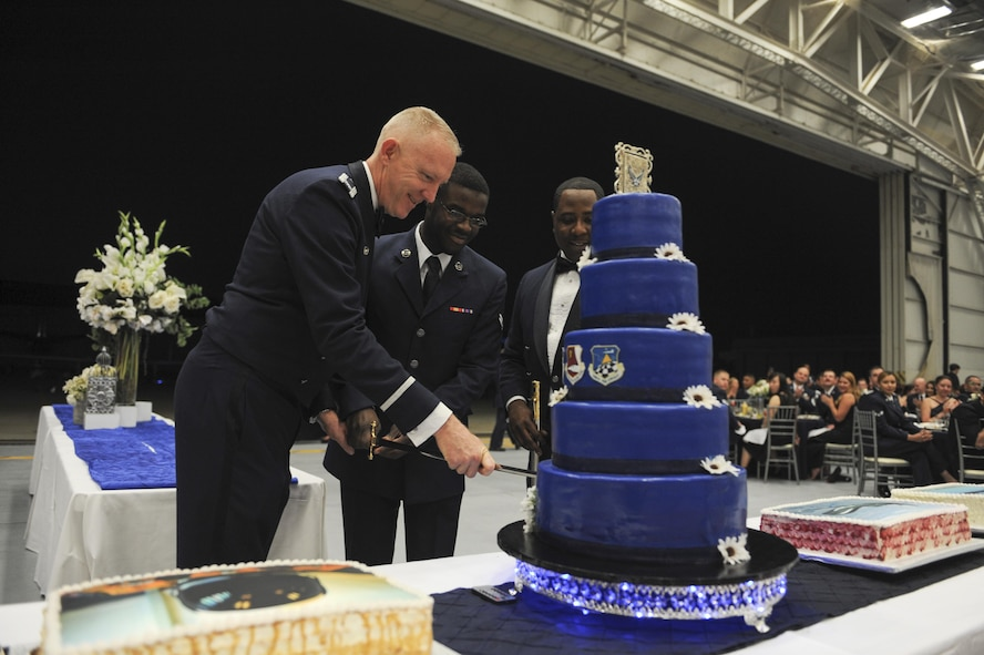 The longest serving  Airman and the youngest Airman us a saber to cut the Air Force cake at Beale Air Force Base, California, Sept 17, 2017. The Air Force was officially recognized as a branch of service on Sept. 18, 1947. (U.S. Air Force photo/Senior Airman Justin Parsons)
