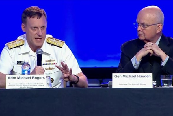 Navy Adm. Mike Rogers, U.S. Cyber Command commander, National Security Agency director and Central Security Service chief, participates in a panel on breaking the cyber barrier at the Air Force Association's Air, Space and Cyber Conference in National Harbor, Md., Sept. 18, 2017.