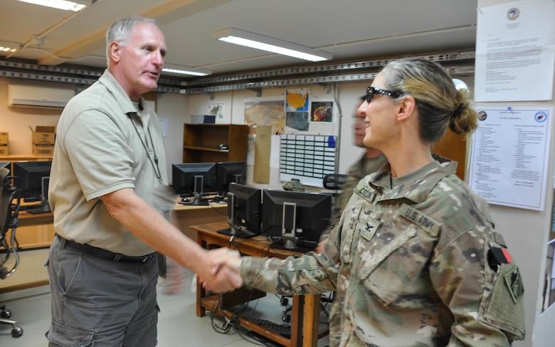 Marmal Resident Office Construction Representative Art Kunigel greets U.S. Army Corps of Engineers' Transatlantic Afghanistan District Commander U.S. Army Col. Kimberly Colloton at Camp Marmal, Sept. 19.
