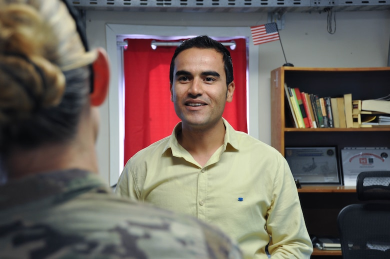 Ahmad Baktash, U.S. Army Corps of Engineers' Transatlantic Afghanistan Lead Local National Engineer, at the Marmal Resident Office at Camp Marmal, Baktash shares his extensive experience working with USACE TAA with TAA District Commander U.S. Army Col. Kimberly Colloton at Camp Marmal, Sept. 19.