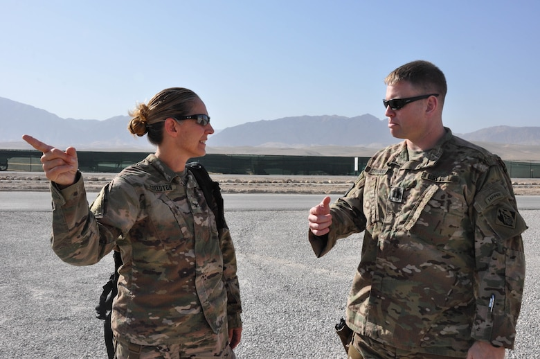 Marmal Resident Office OIC U.S. Army Capt. Daniel Strasser, right, speaks with U.S. Army Corps of Engineers' Transatlantic Afghanistan District Commander U.S. Army Col. Kimberly Colloton, left, about Mazar-i-Sharif and the surrounding area upon arrival at Camp Marmal, Sept. 19.